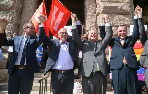 IMAGE DISTRIBUTED FOR HUMAN RIGHTS CAMPAIGN - Human Rights Campaign president Chad Griffin, Jim Obergefell, Mark Phariss and Vic Holmes, from left, cheer in support of last Friday's U.S. Supreme Court marriage equality ruling during a press conference to discuss its local effect on Monday, June 29, 2015 in Austin, Texas. Obergefell is the named plaintiff in the historic same-sex marriage case. Phariss and Holmes are Texas marriage equality plaintiffs. (Jack Plunkett/AP Images for Human Rights Campaign)